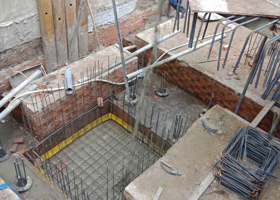 giai đoạn đổ đáy hố pit thang máy tầng hầm